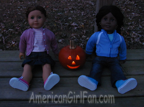 Felicity and Addy with lighted pumpkin
