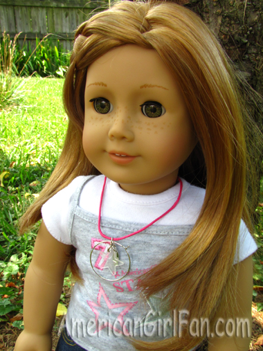 Mia wearing charm necklace