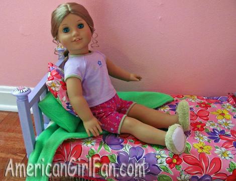 Elizabeth sitting on the bed..