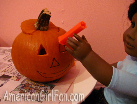 Addy carving pumpkin face
