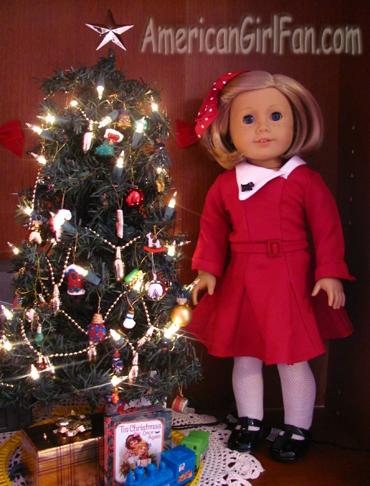 Kit next to the Christmas Tree
