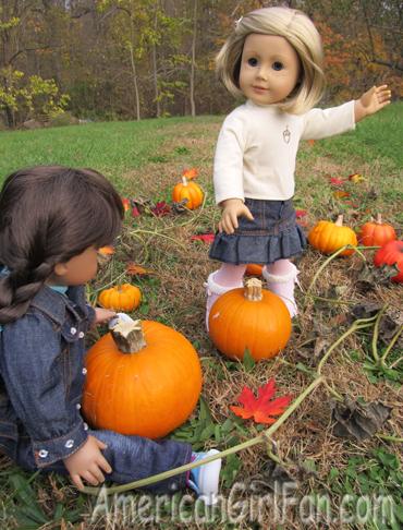 Kit looking at the pumpkin