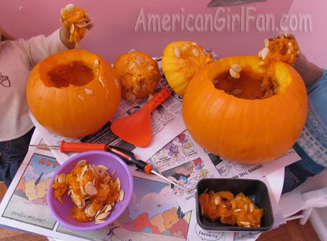Both getting out pumpkin goop