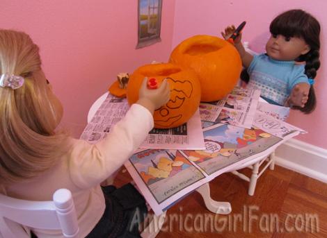 Carving their pumpkins