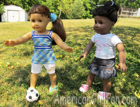 Felicity and Addy playing soccer
