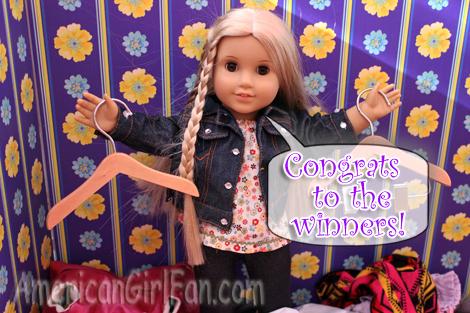 Julie holding hangers congrats